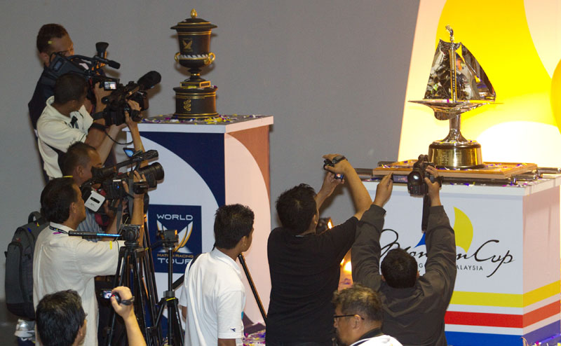 Members of the media take photos of the Monsoon Cup and the ISAF Match Racing World Championship trophy