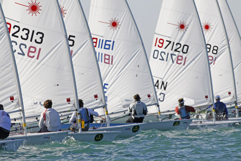 The Laser fleet at the start on race day two