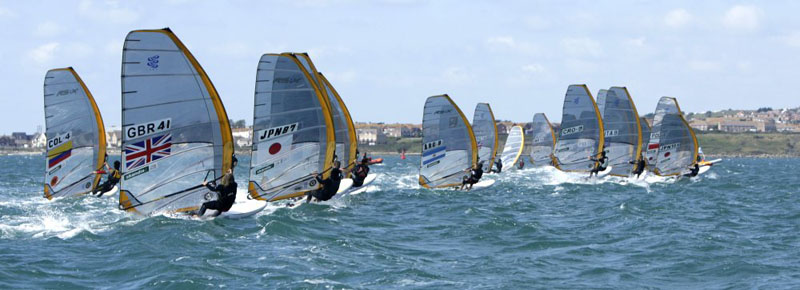 The Men's RS:X fleet fly off the line