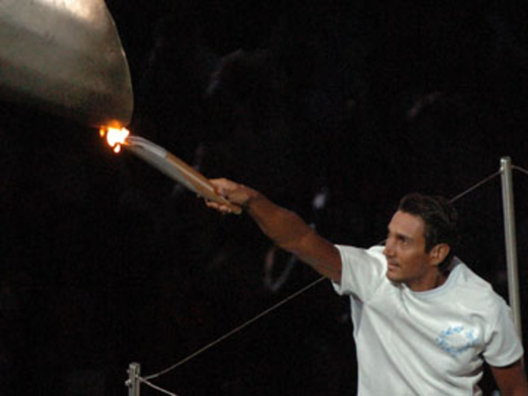 Nikolas KAKLAMANAKIS lights the Olympic Flame in Athens