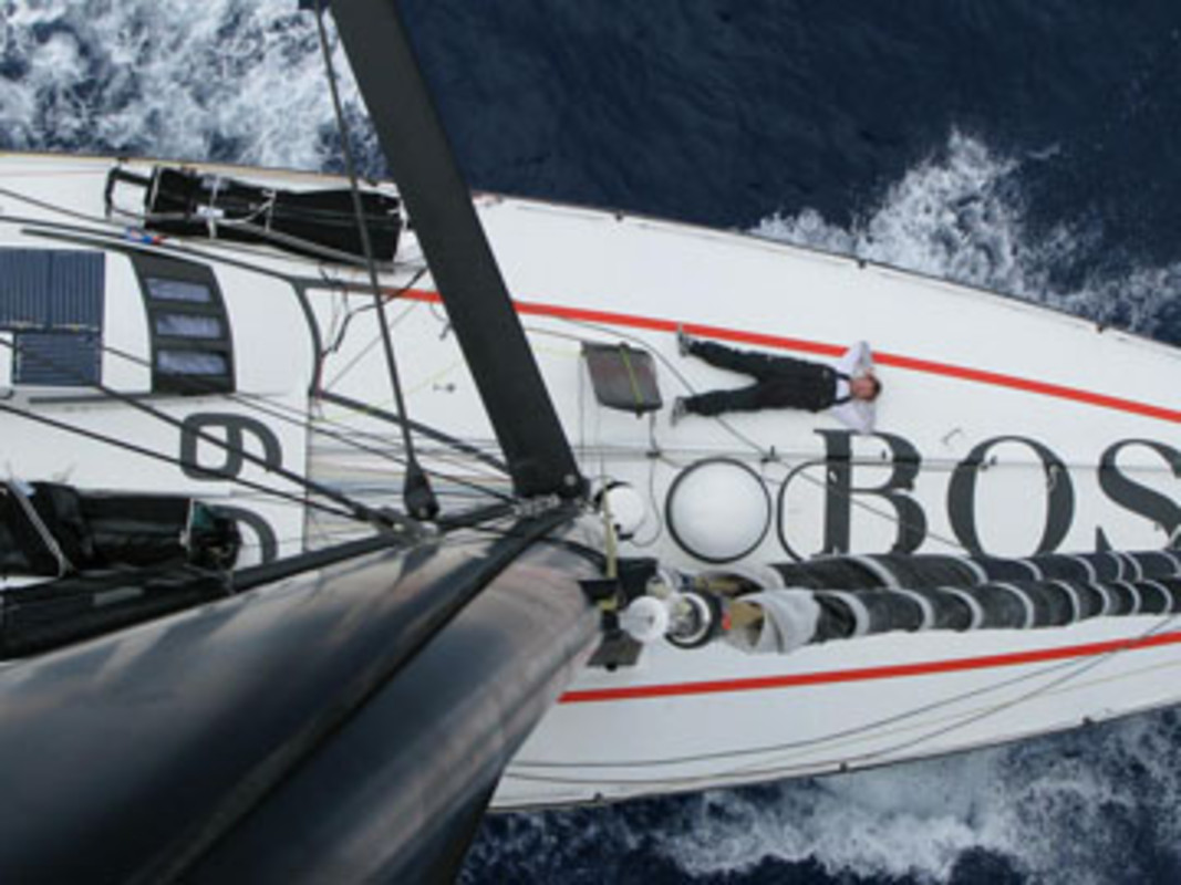 Andrew CAPE catches up on some sleep on the bow of Hugo Boss