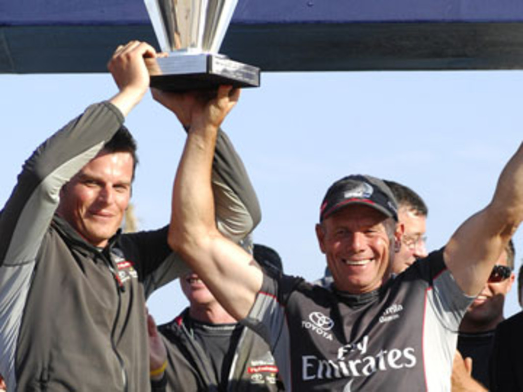 Emirates Team New Zealand helmsman Dean BARKER and MD Grant DALTON hold aloft the Louis Vuitton Cup