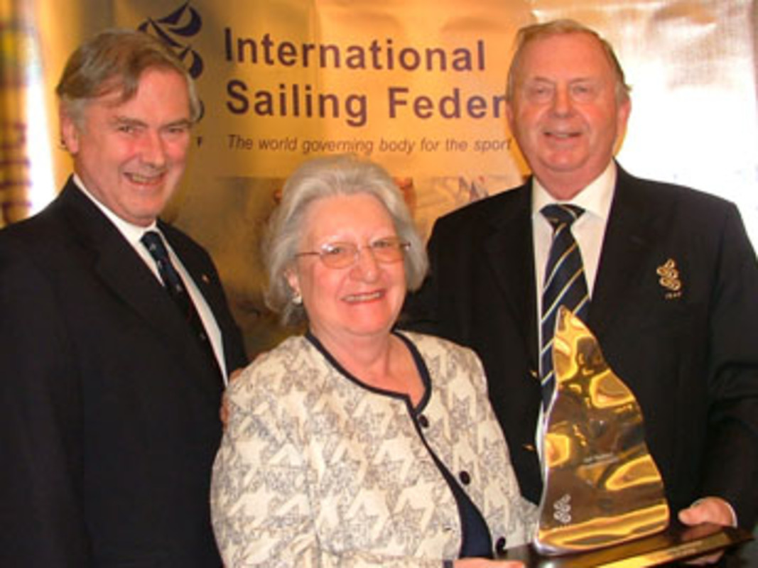 From left to right, Robert WILKES and Helen-Mary WILKES are presented with the ISAF President Development Award by ISAF President Göran PETERSSON