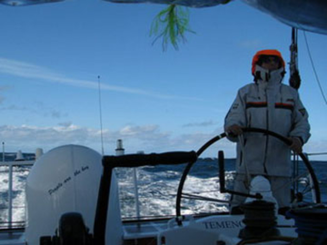 Dominique WAVRE at the helm onboard Temenos II