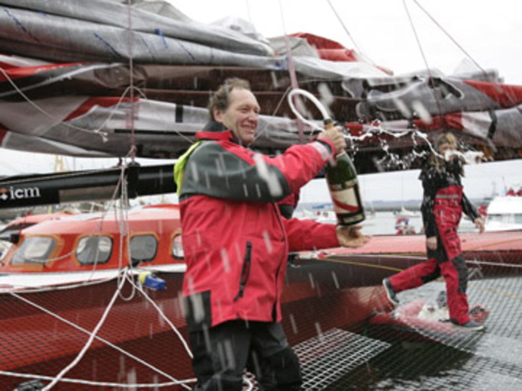 Francis JOYON celebrates at the end of his world record voyage