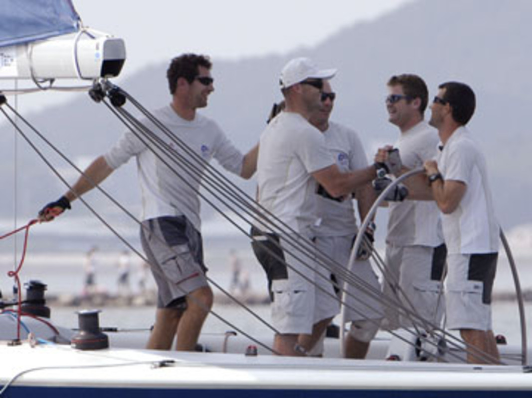 Seb COL and the K Challenge/French Match Racing Team celebrate as they cross the finish line