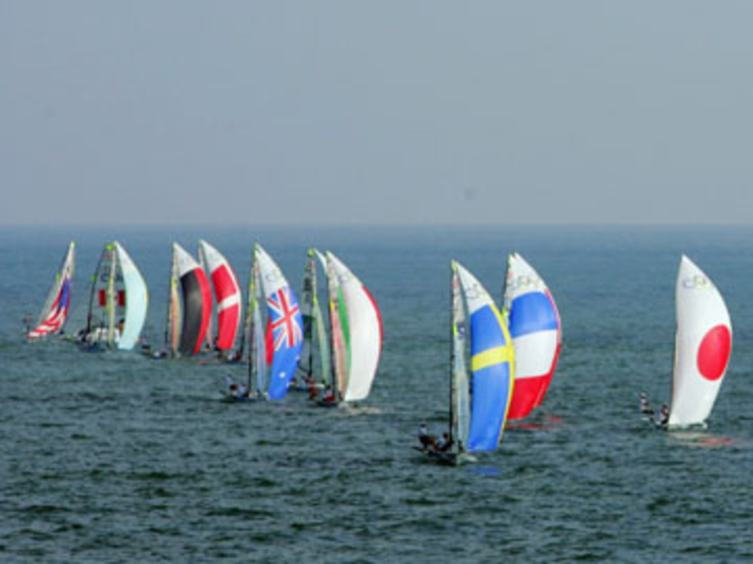 Pietro Sibello and Gianfranco Sibello of Italy lead the field in race 3 of the 49er