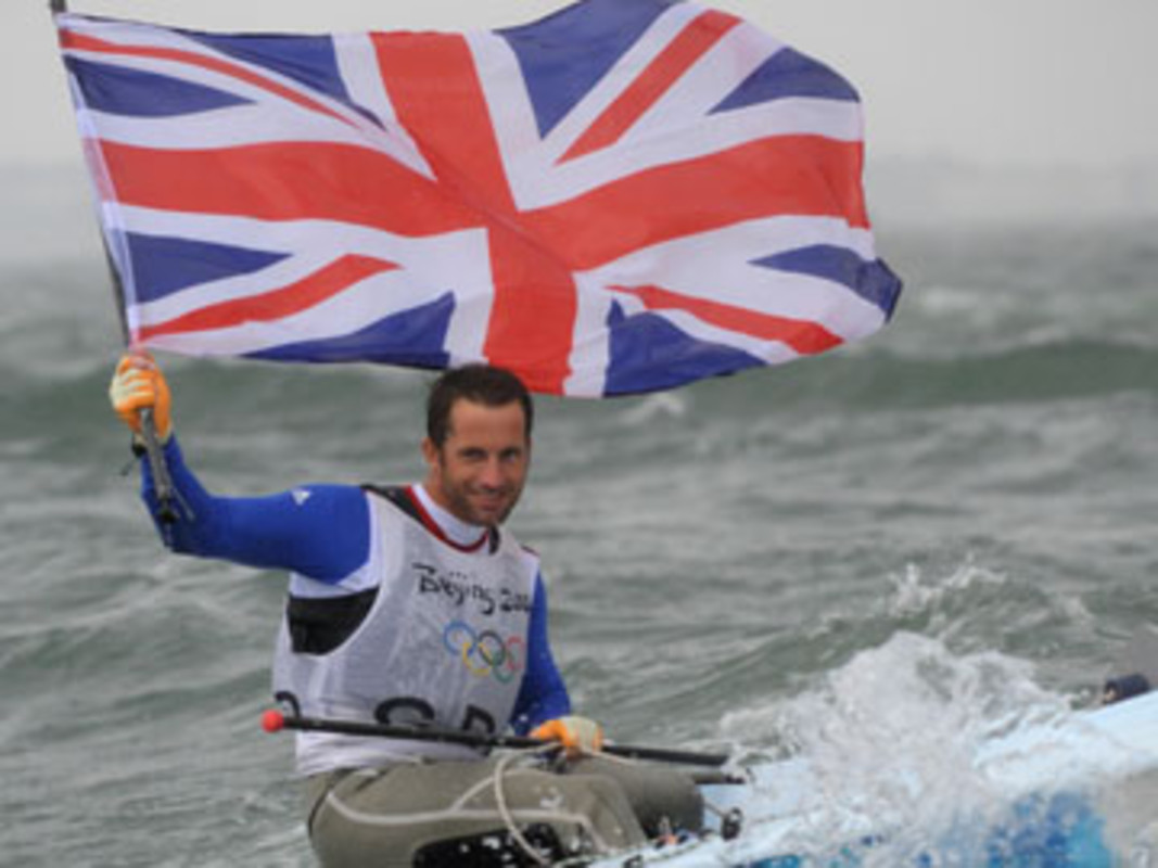 Ben AINSLIE celebrates his gold medal at the Beijing Olympic Games