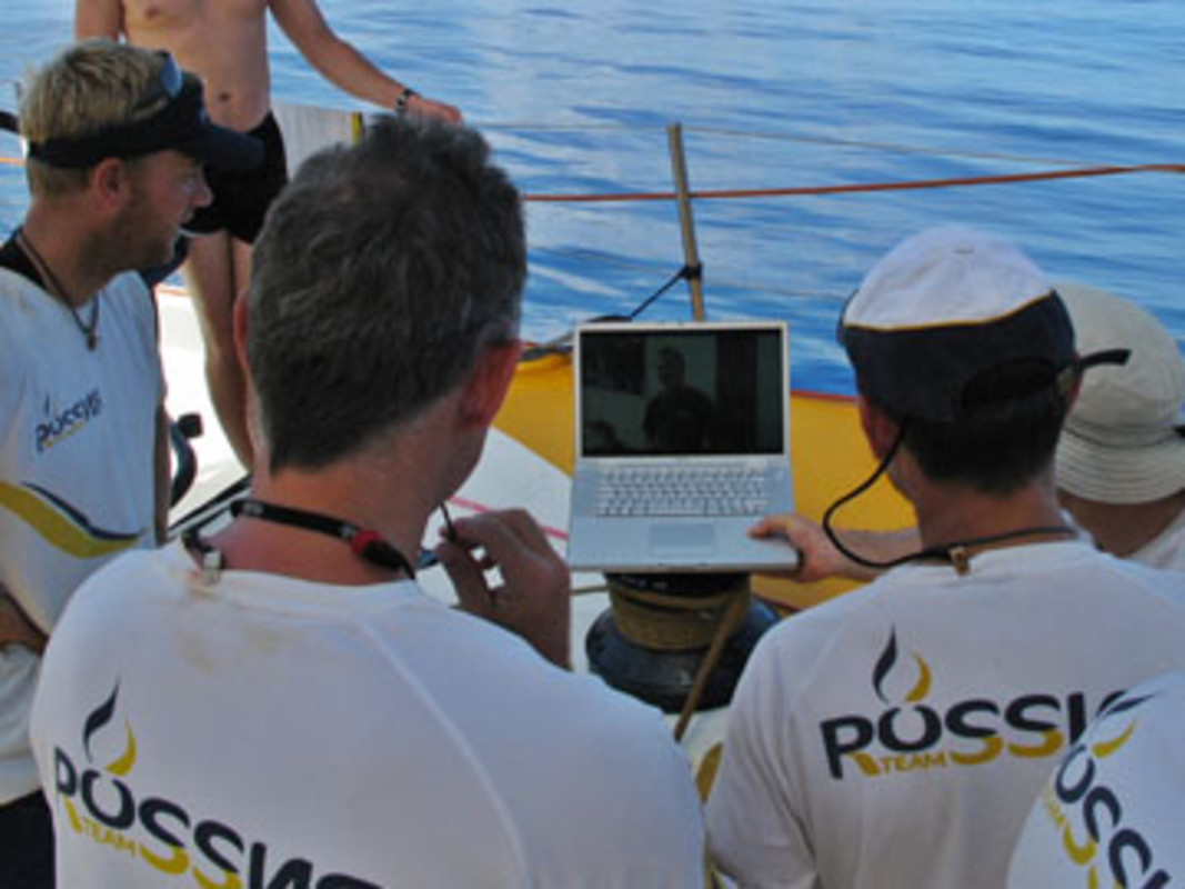 The crew of Team Russia watch a good luck DVD from the shore crew in the heart of the Doldrums