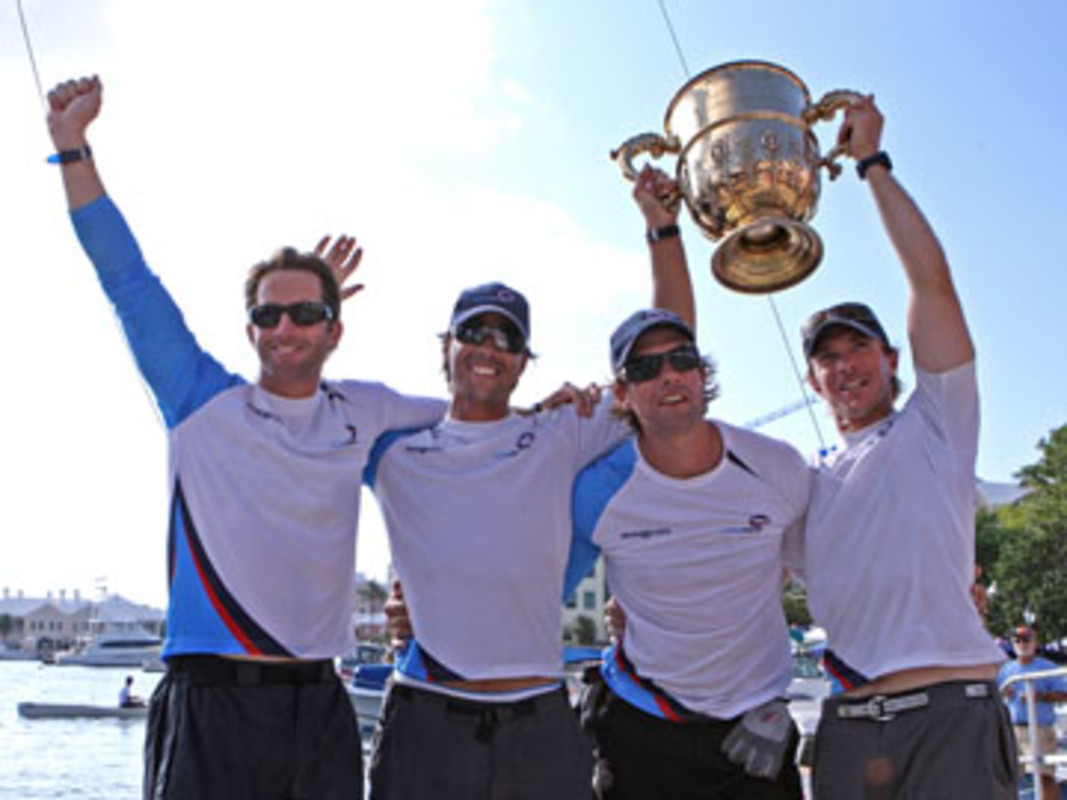 Ben Ainslie (left) and Team Origin celebrate with the King Edward VII Gold Cup