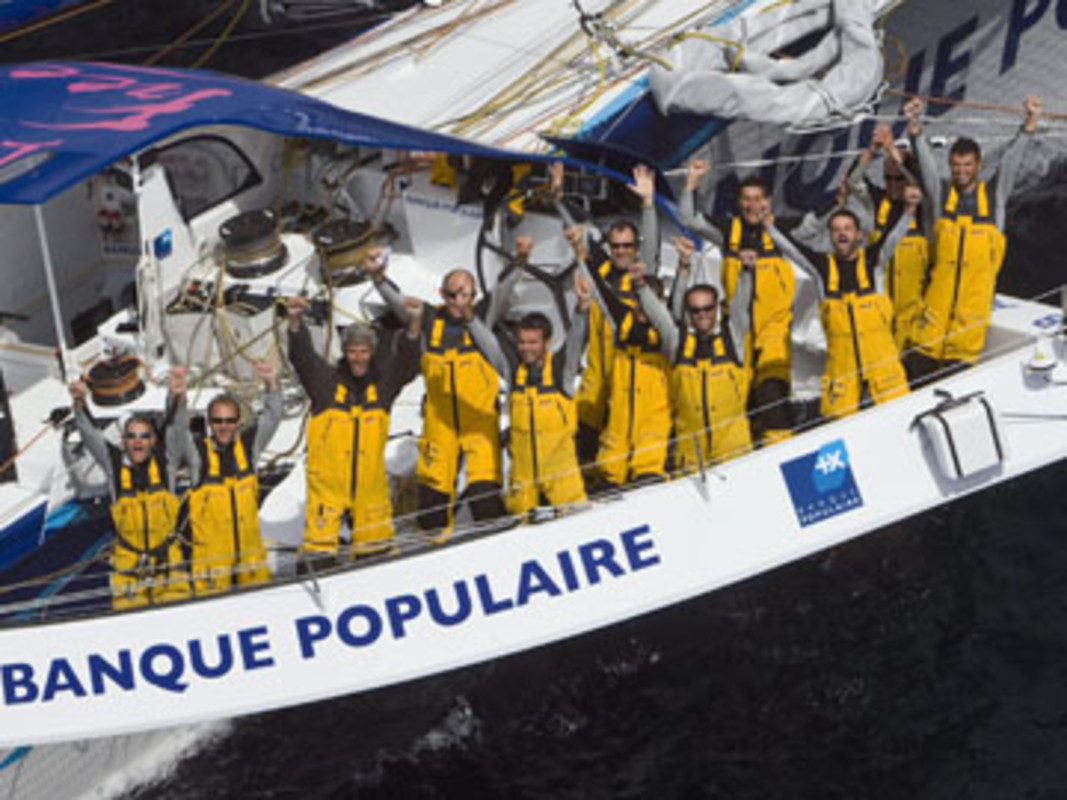The Banque Populaire V team celebrate their record breaking transatlantic crossing