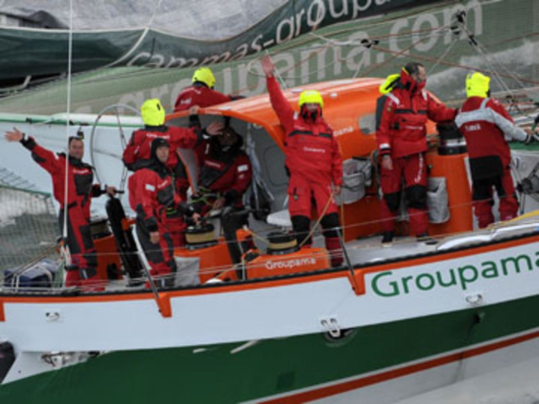 Franck Cammas and his crew wave goodbye as they depart Ushant