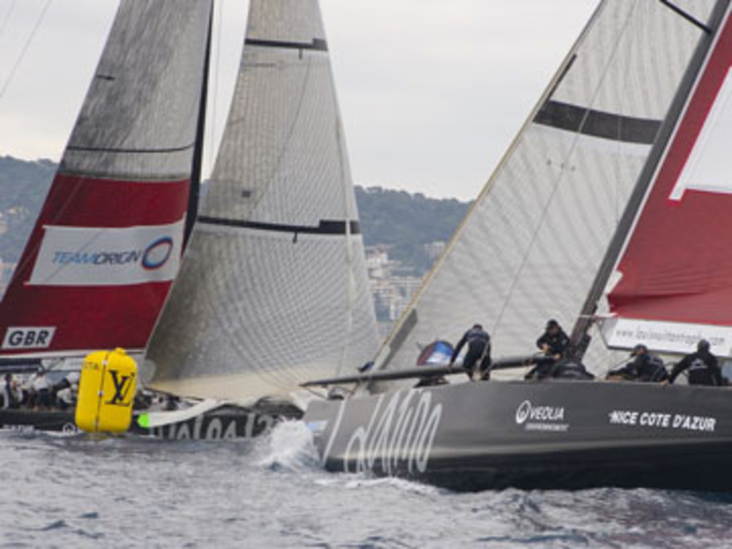 TeamOrigin wriggles around the windward mark just ahead of Emirates Team New Zealand