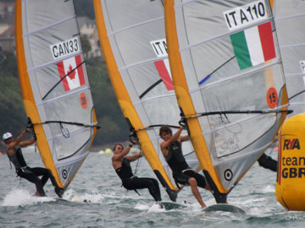 The Men's RS:X fleet battle for position on day four of racing in Weymouth