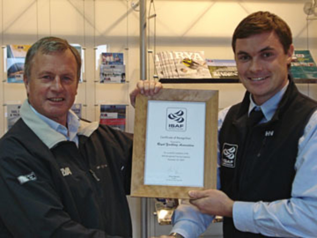 Dan Jaspers (r), ISAF Training and Development Manager, presents James Stevens, RYA Training Manager, with a certificate confirming the RYA's accreditation for ISAF Recognized Training status