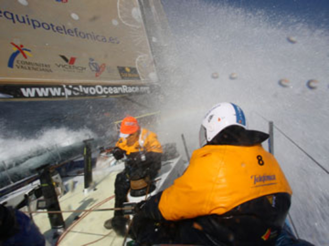 Jordi CALAFAT and Pablo ARRARTE covering themselves from an imminent cold shower onboard Telefonica Blue