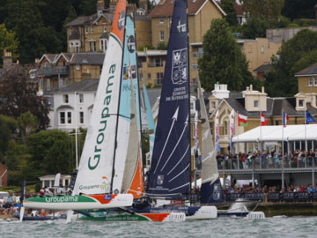 Groupama 40 and Groupe Edmond de Rothschild racing in front of the race village in Cowes 2010.
