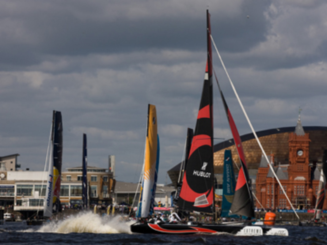 Alinghi stick in their heels as they round the orange Wales mark in the gusty conditions on day 2 of racing.