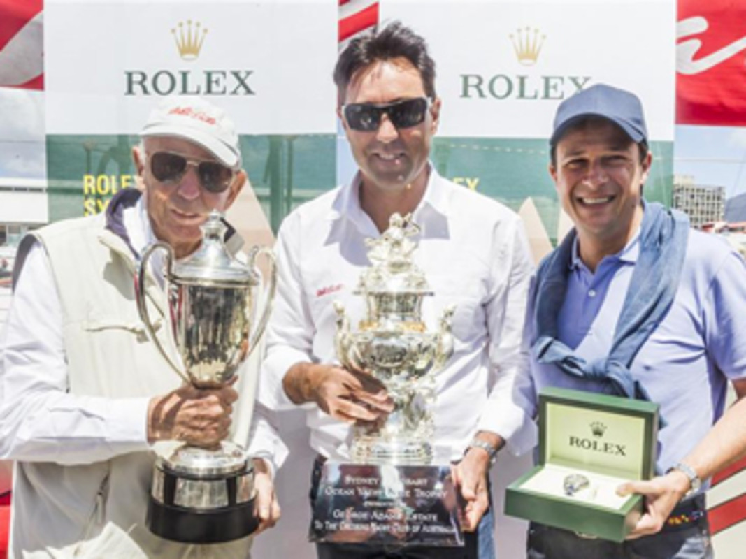 Bob Oatley, Owner WILD OATS XI, and Skipper Mark Richards receive Tattersall's Cup & a Rolex Timepiece from Patrick Boutellier (Rolex Australia)