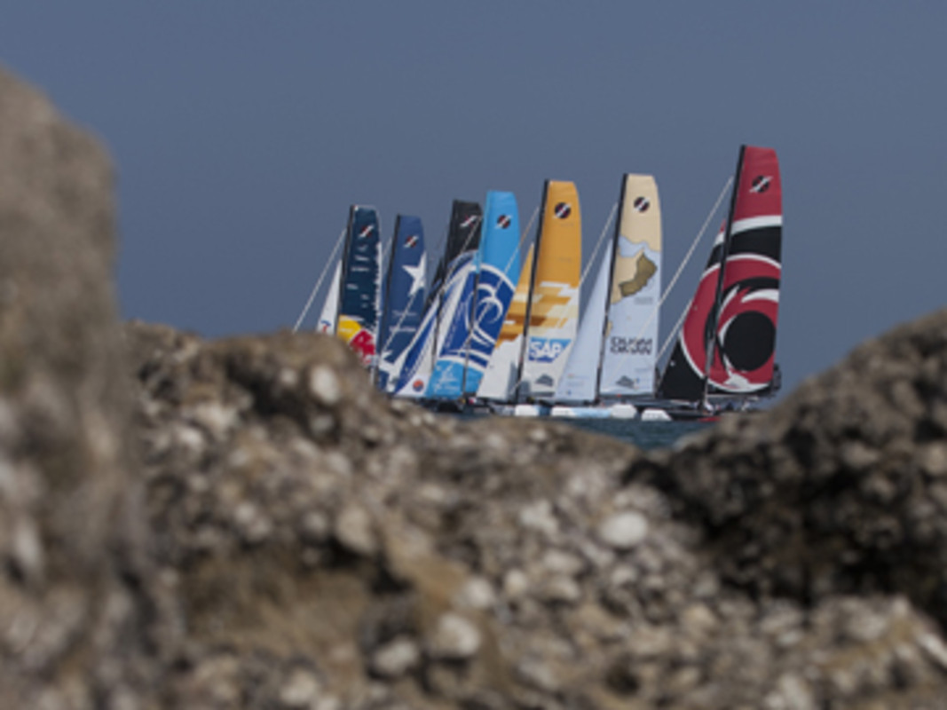 Fleet race against the Muscat backdrop on the penultimate days racing