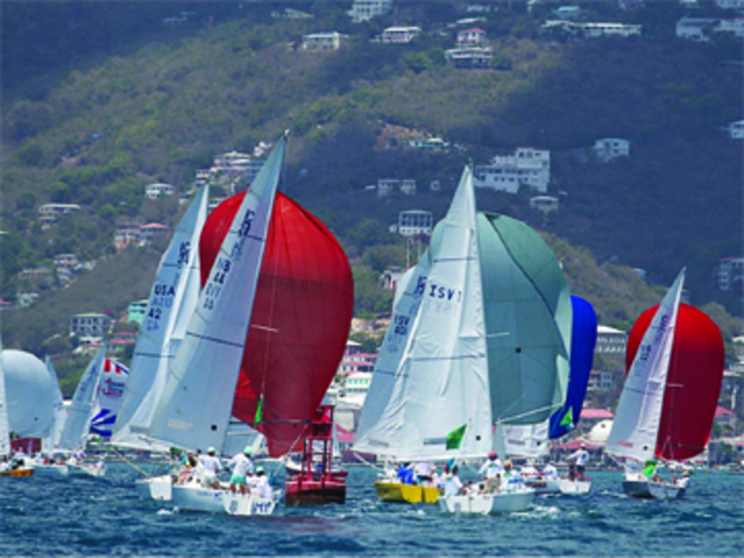 A pageantry of colorful spinnakers add excitement to Charlotte Amalie harbor.