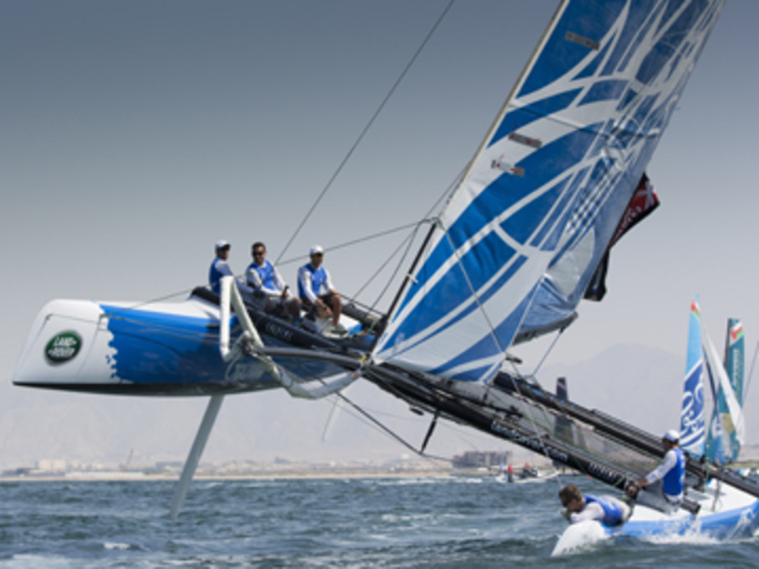 Gazprom Team Russia fly a hull as they push their Extreme 40 hard around the track