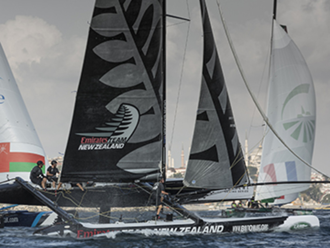 Emirates Team New Zealand fly a hull as they power downwind and push their Extreme 40 around the track