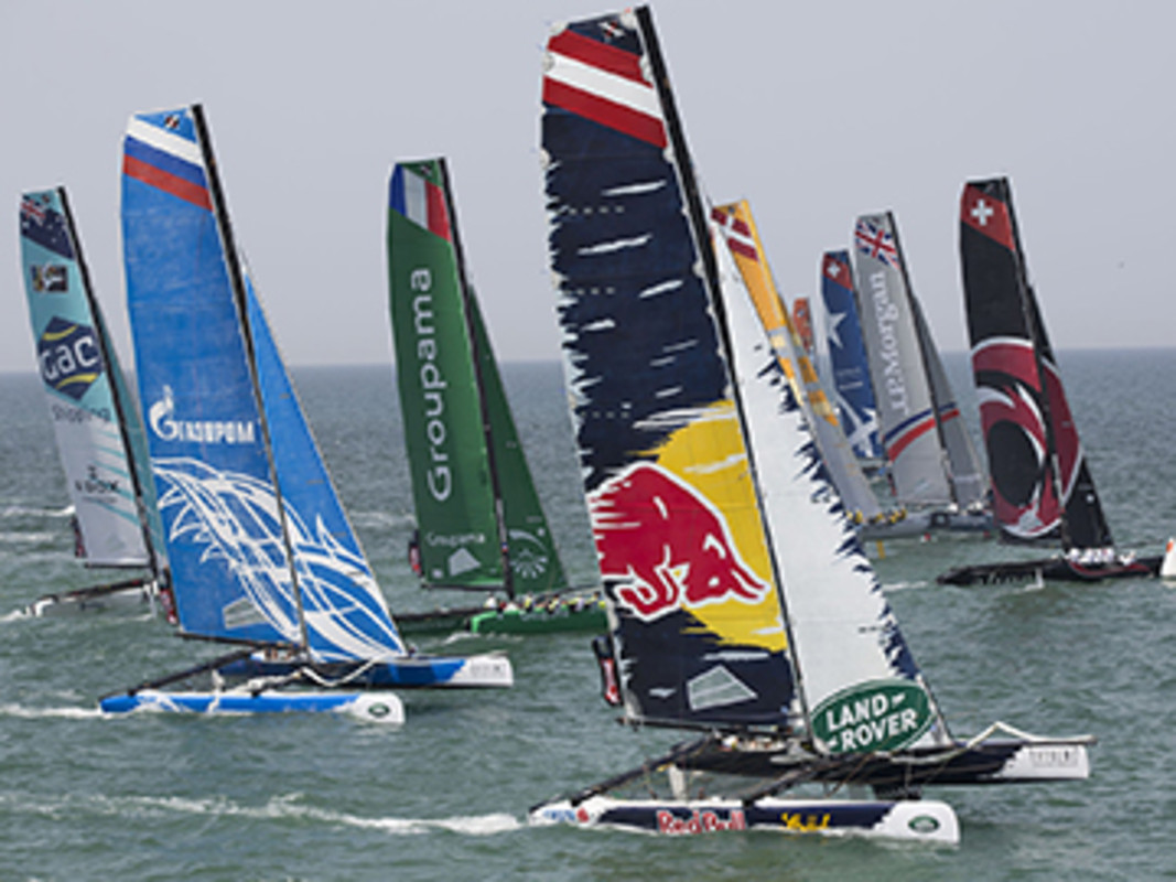The fleet power off the startline