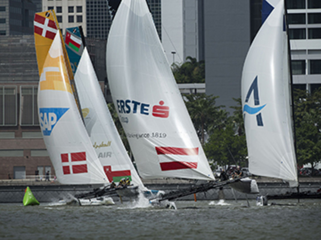 Red Bull Sailing Team lead the fleet as they fly downwind.