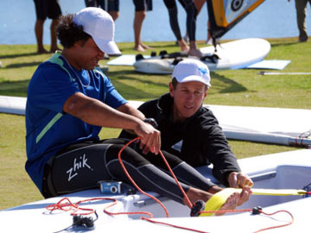 ENP Coach Arthur BRETT correcting Cook Islands Laser sailor Peter HENRY's technique